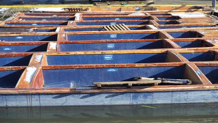 Cambridge, England. Empty wooden boats used for tours along the river
