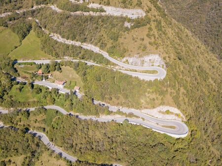 Drone aerial view of the mountain road in Italy. Bends creating beautiful shapes