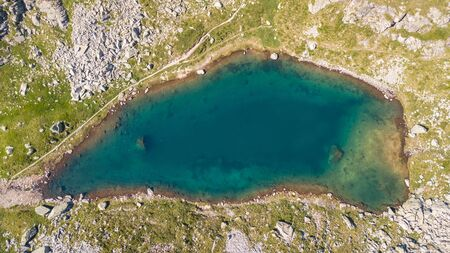 Italian Alps. Italy. Up and down drone aerial view of the natural alpine lake. Orobie. Valgoglio lakes 写真素材