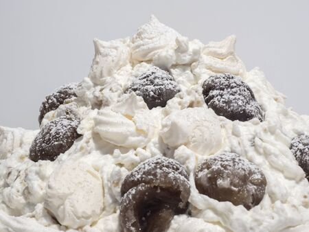 Delicious sweet mont blanc. Dessert made with whipped cream, meringues, marron glacé and covered with icing sugar Banco de Imagens