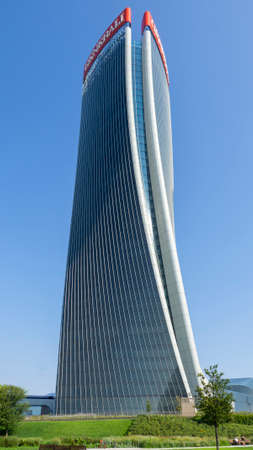 Milan, Italy. The iconic Generali tower at CityLife district designed by Zaha Hadid. Skyscraper which is part of a group of residential and business buildings. Modern buildings