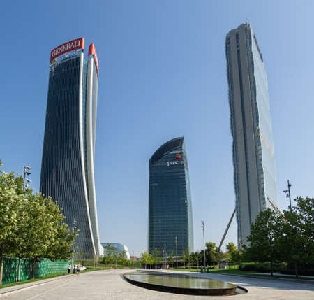 Milan, Italy. The iconic Generali, Allianz and PWC towers at CityLife district. Skyscraper which is part of a group of residential and business buildings. Modern buildings