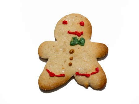 Group of homemade Christmas gingerbread cookie isolated on white background. Male or female cookies. Decorated Christmas cookies