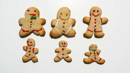 Group of homemade Christmas gingerbread cookies isolated on white background. Male or female cookies. Decorated Christmas cookies
