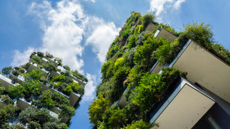 Milan, Italy. Bosco Verticale, view at the modern and ecological skyscraper with many trees on each balcony. Modern architecture, vertical gardens, terraces with plants