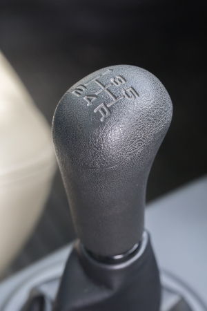 sequential: black manual gear in the car