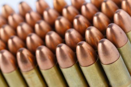 luger: A group of 9mm bullets on white background