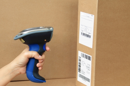 barcode scanning: Bluetooth Barcode and QR Code Scanner, showing scan barcode lebel on the box  Stock Photo