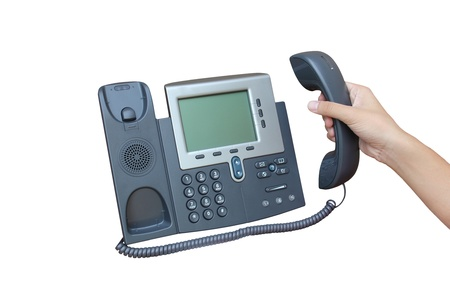 Holding IP phone isolated over white backgroud photo