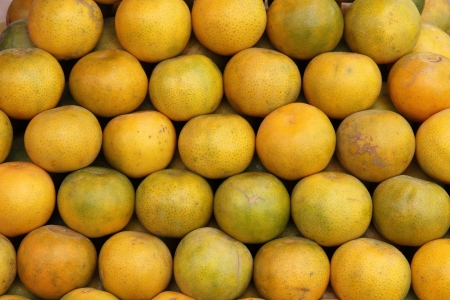 Plenty of tangerines, for sale on a market stall in Thailand Stock Photo - 16608377