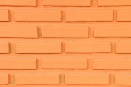 Background of orange brick wall texture  Stock Photo