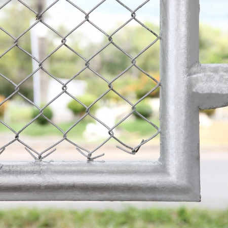 Mesh fence with silver border