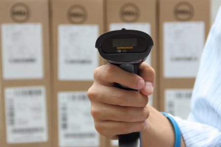 Barcode label scanner with label on the boxes background Stock Photo