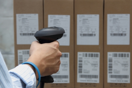 readers: Scanning the label on the boxes with barcode scanner