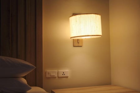 In the night with single lamp in the bedroom, a cheaper price hotel in Bangkok, Thailand