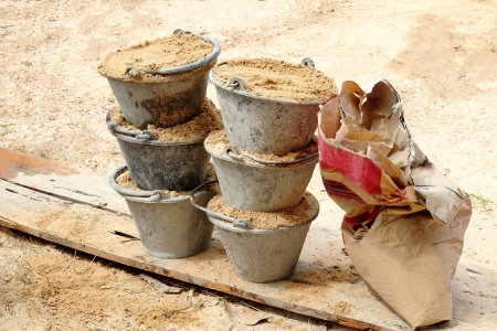 Sand in bucket for cement mixing Stock Photo