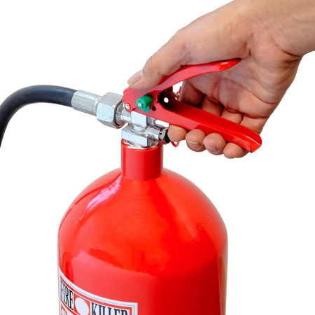 using: Holding fire extinguisher isolated over white background