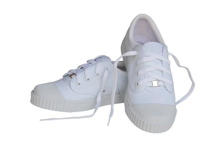 zapatos escolares: Zapatos llanos blancos aislados sobre fondo blanco