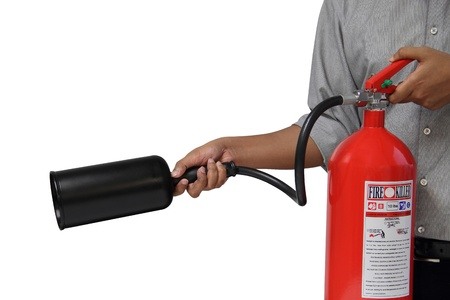 fire safety: A man showing how to use fire extinguisher isolated over white background