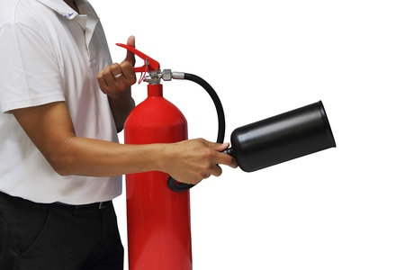 fire safety: A man showing how to use fire extinguisher. Stock Photo