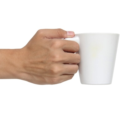 Man holding a ceramic cup isolated over white background photo