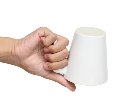 Man flip over a ceramic cup isolated over white background photo