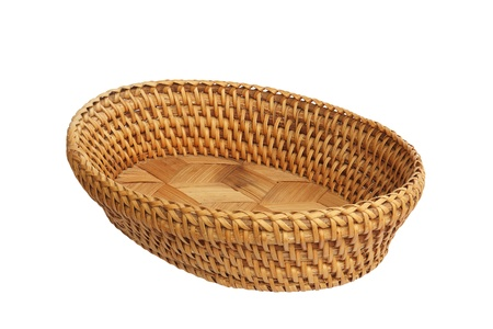 An empty wicker basket isolated over white background  Basket used for arrangement of flower or fruit  Stock Photo