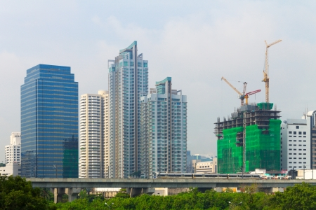 constructing: High condominium, Business and constructing building behind the sky train in the metropolis city.