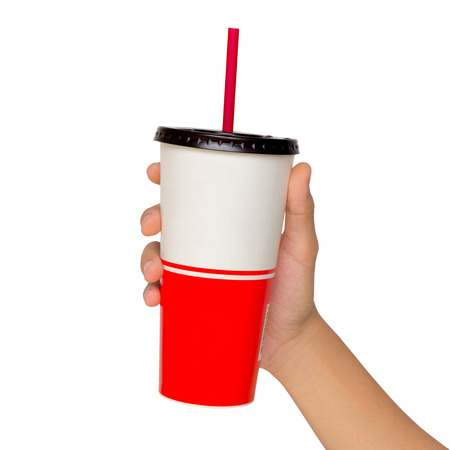 Holding a paper cup with tube isolated over white background photo