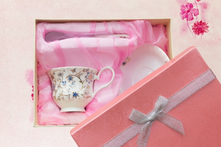 Gift set of cup, plate and spoon in open box  Stock Photo