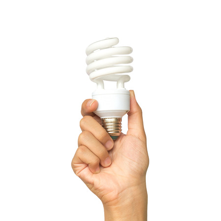 Holding and lift up a spiral light bulb in hand - creativity concept of ideas, clever and intelligent