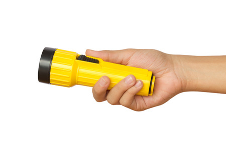 Hand holding yellow flashlight- concepts of searching and direction Stock Photo