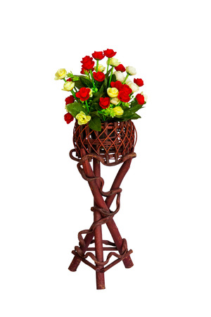Decoration and collection of fabric artificial flowers in wooden stand