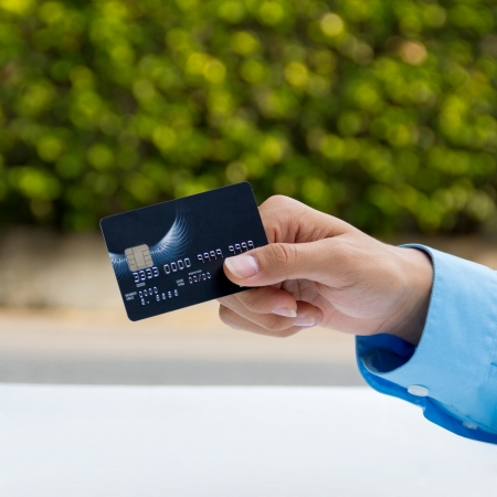 Closeup of hand holding credit card Stock Photo - 24906727