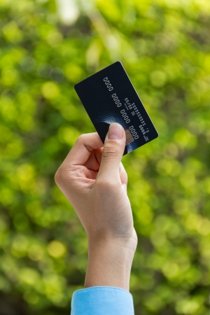 Closeup of hand holding credit card