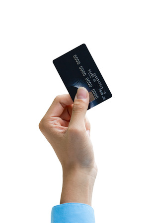 Closeup of hand holding credit card isolated over white photo