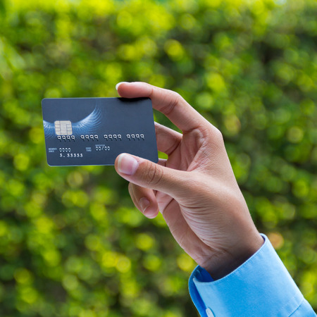 Closeup of hand holding credit card photo