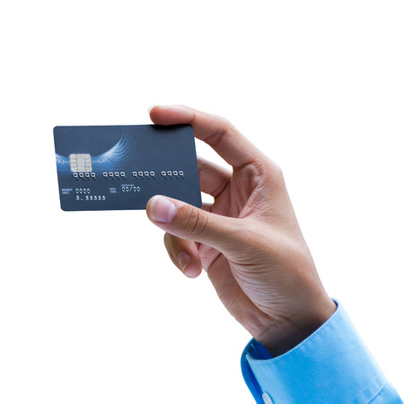 Closeup of hand holding credit card over white background, ready for payment Standard-Bild