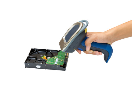 Holding and Scanning on the harddisk with wireless barcode scanner isolated over white background photo