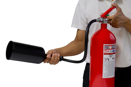 fire hazard: A man showing how to use fire extinguisher isolated over white background