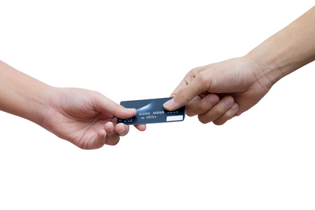 Holding and giving credit card over white background