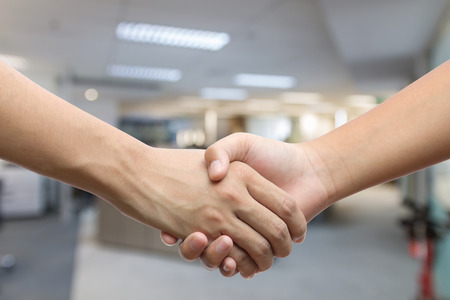 Hand holding hand isolated over white background - Friendship, Business, Handshake, Congratulation