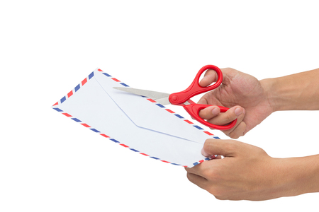 Cutting a letter or paper, Openning an envelope with scissors isolated on a white background