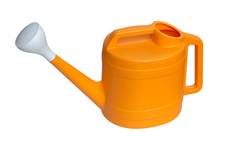 Yellow plastic watering can isolated over white background