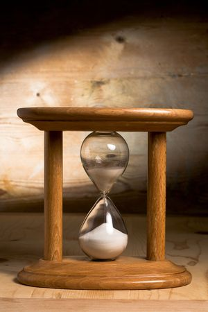 Hourglass on Wooden Background  photo