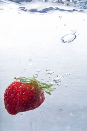 sidelight: Strawberry in Water Stock Photo