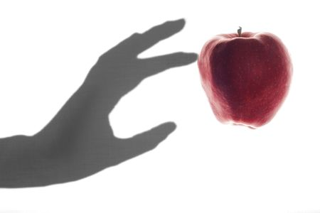 touched: Apple Touched by a Shadow Hand Stock Photo
