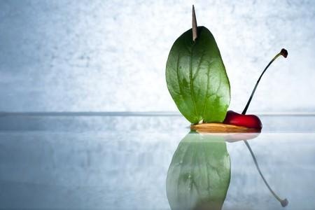 nutshell: Cherry on a Nutshell Boat Stock Photo