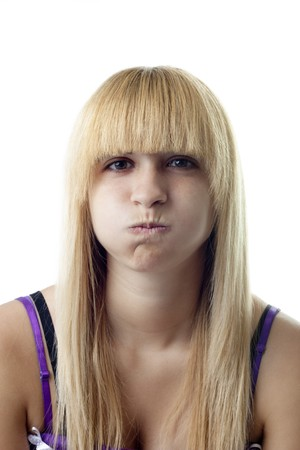 Girl Blowing Her Cheeks Stock Photo - 7424316