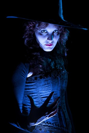 Pretty Witch in Blue Light Stock Photo - 7705830